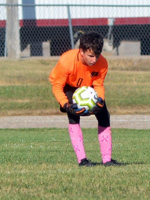 McPherson keeper Kelvin Peterson scoops up a ball during play in the regional finals in Elbing.
