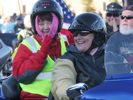 Dawn Derleth of Tomahawk, who has a visual disability, was given a ride in the Thunder Parade in 2011. Each year riders give people with disabilities or who are elderly free rides in the event.