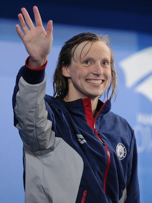 Katie Ledecky of the USA smiles on the podium after winning the 800m freestyle during day one of the 2014 Pan Pacific Championships.