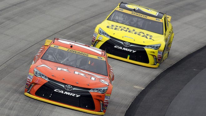 Carl Edwards, front, ranks fifth of the 12 remaining drivers in the Chase  for the Sprint Cup standings, but teammate Matt Kenseth is last.