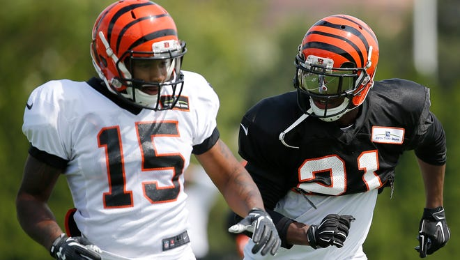 Cincinnati Bengals cornerback Darqueze Dennard, right, defends wide receiver Mario Alford during Cincinnati Bengals training camp, Tuesday, Aug. 4, 2015, on the practice fields adjacent to Paul Brown Stadium