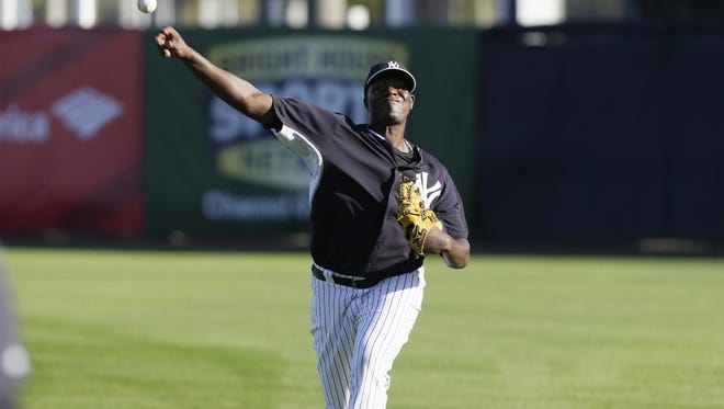 New York Yankees starting pitcher Michael Pineda throws in the outfield during spring training baseball practice on Feb. 20, 2014, in Tampa, Fla.
