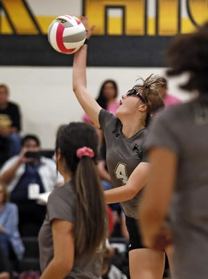 Lubbock's Kennedy Scheppler (4) hits the ball over the net during a District 3-5A match against Monterey on Oct. 1, 2019 at Lubbock High School.