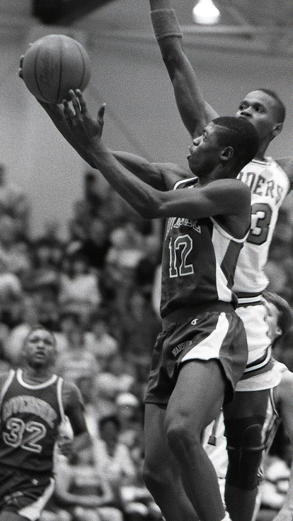 Riverside's Shaun Golden (12) drives to the basket past Greenville's David Young (23) during the Class AAA Upper State championship March 8, 1988. Riverside defeated Greenville 73-55 at Presbyterian College.