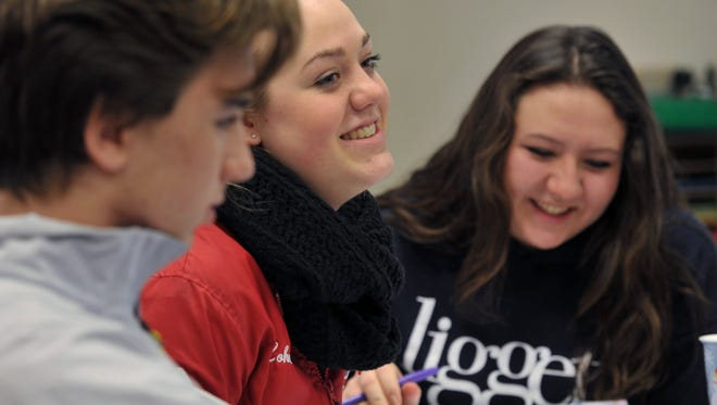 Liggett students Nick Brusilow of Grosse Pointe, Rebecca Lohman of Brownstown Township and Hollie Kien of Harper Woods discuss the origins of French settlers in their U.S. history class, which studies American history through the lens of Detroit and the region. The class, launched last year, was honored with a state history award for educational programs from the Historical Society of Michigan.