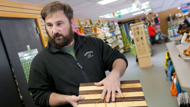 Milwaukee County Zoo arborist Alex Krutsch made this cutting board from reclaimed walnut and sugar maple wood.