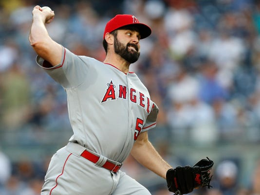 Los Angeles Angels starting pitcher Matt Shoemaker (52) delivers during the first inning of a baseball game against the New York Yankees at Yankee Stadium in New York, Monday, June 6, 2016. (AP Photo/Kathy Willens)