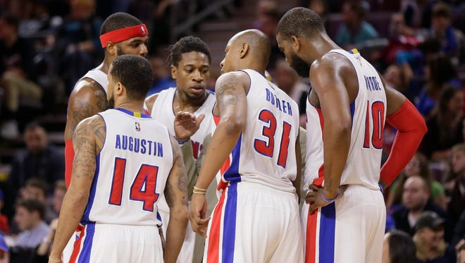 Detroit Pistons, from left, Josh Smith, D.J. Augustin, Cartier Martin, Caron Butler and Greg Monroe huddle during the second half against the Philadelphia 76ers in Auburn Hills on Saturday, Dec. 6, 2014.
