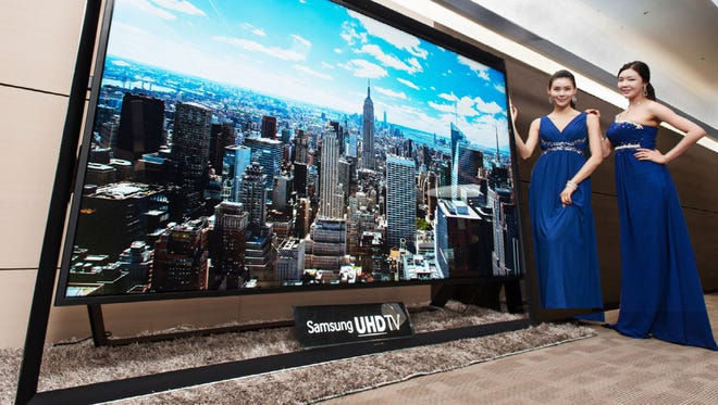 Models pose with a Samsung Electronics' 110-inch UHD TV. Samsung on Monday said a 110-inch UHD TV that has four times the resolution of standard high-definition TVs is going on sales for about $150,000 in South Korea.