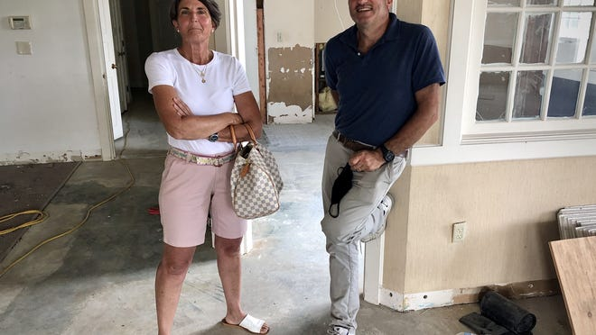 Julia and Elie Karam are pictured here inside a former BankFive building in Somerset that the couple are transforming into a liquor store.  Herald News photo by Charles Winokoor