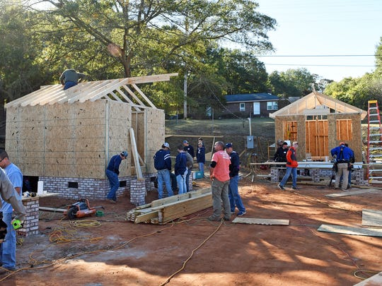 Volunteers work on building tiny houses of Opportunity Village, a program for homeless to be operated by the Dream Center of Pickens County.