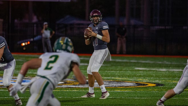 Benedictine's Holden Geriner (11) looks to pass the ball during the game against Blessed Trinity in 2019 at Memorial Stadium.