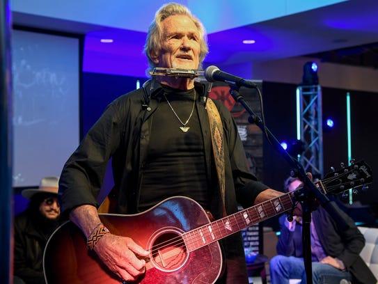 Kris Kristofferson sings at the press conference regarding