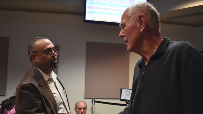 Mayor Richard Boss and opponent Paul Sanchez shake hands after Boss was unofficially declared the winner of the mayor's race on Tuesday evening.
