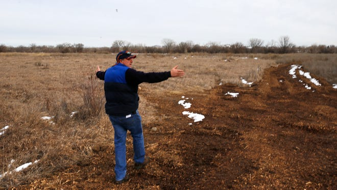 Ken George, director of the Aztec Electric Department on Tuesday shows the area where city officials plan to install a solar farm in Aztec.