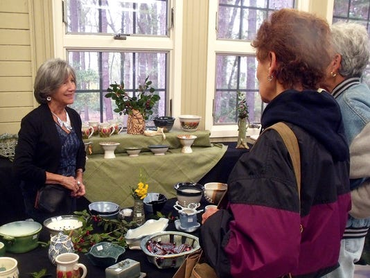 Carmela Coleman, potter talks with two Holiday Fair guests.JPG