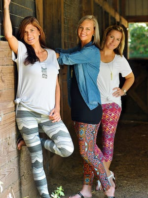Lisa Beggs, LaluRoe Sales Consultant, Holly Bunnell,Trainer and JennMarman, Sale Consultant modeling Lularoe Buttery Soft Leggings and Classic T. LuLaRoe is comfortable clothing which is only available through social media.