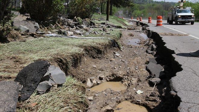Large portions along the side of Rt. 364 in Penn Yan were washed away by the flood.