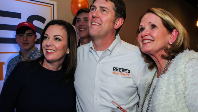 Amanda and Shane Reeves along with Rita Ash look at voting returns during a campaign celebration held Tuesday, March 13 at Five Senses restaurant in Murfreesboro.