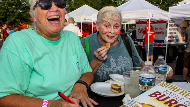 Battle of the Burger 2018: Jean Bogle votes while Sue Moore sneaks a peak.