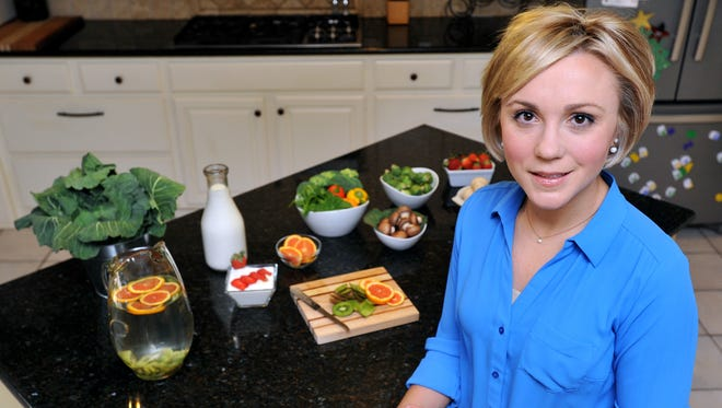 Registered dietitian Rebecca Turner uses fruit and other items to create calorie saving drinks.