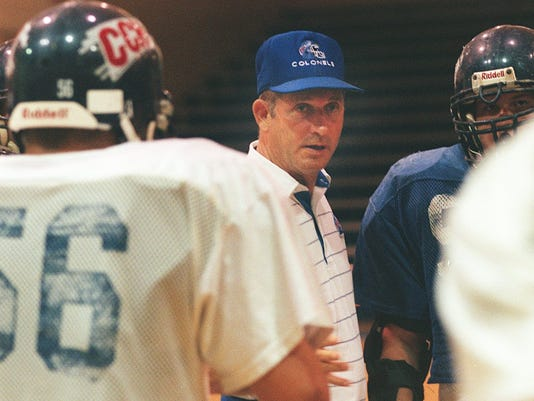 Text: 1999.0929.13.kyfootball01-Covington Catholic H.S head football coach Lynn Ray talks to his team inside of the gym at Covington Catholic H.S . He is going for his 200th win this weekend.C-E phto by Ernest Coleman for sports.