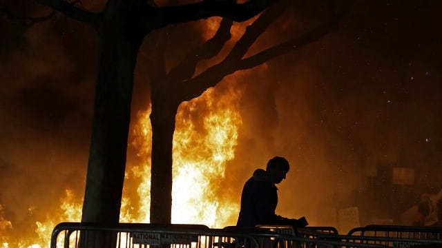 A fire set by demonstrators protesting a scheduled speaking appearance by Milo Yiannopoulos burns on Sproul Plaza on the University of California, Berkeley campus, Feb. 1, 2017.