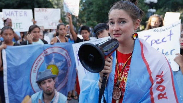 Shailene Woodley and North Dakota Native American children participate in the Stop the Dakota Access Pipeline protest at Union Square on August 7, 2016 in New York City.