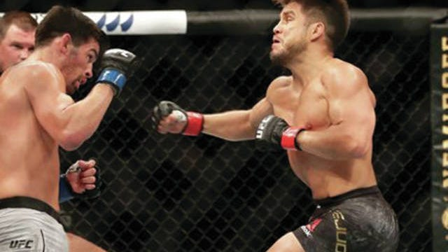 Henry Cejudo punches Dominick Cruz during Saturday night's card in Jacksonville, Fla.