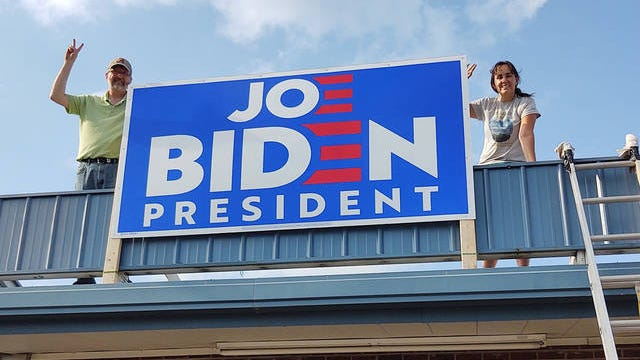 Maury County Democrats Greg Hanners, left, and chair Kendall Azzariti help erect a sign in support of former Vice President Joe Biden at a new party headquarters in Columbia. The building is at 105 E. James Campbell Blvd. near Legends Restaurant and Shoney's. The party will have a grand opening at 10 a.m. and a meeting at 6:30 p.m. Saturday.