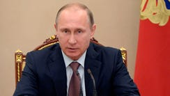 Russian President Vladimir Putin speaks at a Security