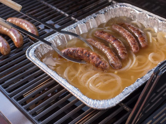 After grilling, the brats can be returned to the onion-beer mixture to keep warm.