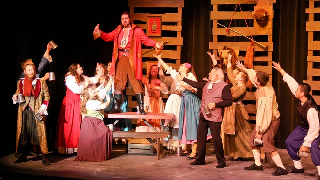 Villagers sing the praises of Gaston (Terry McAuley, top left), who's only too happy to agree with their every word.