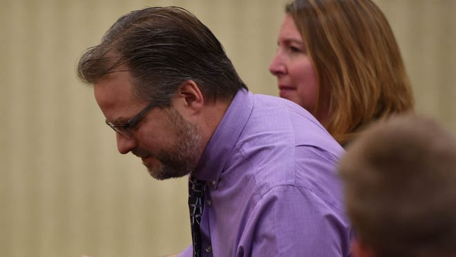 Alisha Bromfield's stepfather and mother, Joe and Sherry Anicich, react after hearing that Brian M. Cooper was denied a retrial in a motion hearing Wednesday in Door County Circuit Court. Cooper, 38, is serving two life prison terms after being convicted of two counts of first-degree intentional homicide of Bromfield.