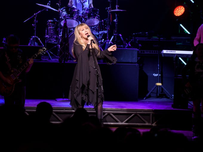 Stevie Nicks of the band Fleetwood Mac performs live