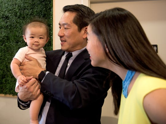 Zoey, 7 months, and Howard Yoon, Lai's husband and