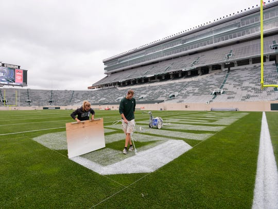MSU Assistant Athletic Turf Managers Georgie Heitshusen,