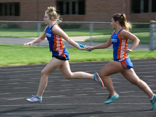 Ladywood runners pass the baton during a special track