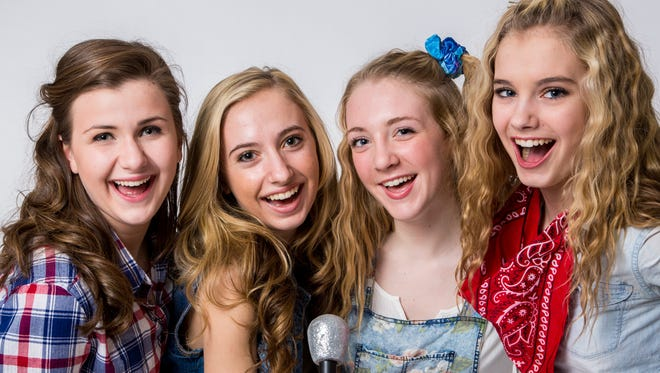 Let's Hear it for the Footloose girls (from left to right) Kirsten Maiwaldt, 15, of Clinton Township; Hannah Mehl, 18, of Lebanon Township; Samantha Brynildsen, 16, of Lebanon Township; and Natalie Mehl, 14, of Lebanon Township. SKIT is presenting the show for the next two weekends at Voorhees High School