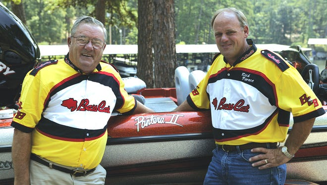 Bass Cat founder Ron Pierce, left, and his son, Rick Pierce, are shown at a recent tournament. From a two-car garage on Tipton Drive to the company's current plant at the Midway industrial park, the Pierce family has created a legacy in the bass fishing boat industry.