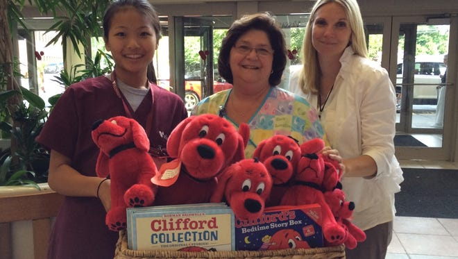 Vassar Brothers Medical Center volunteer Sandy Spencer (left) and Pediatrics Child Life Worker Theresa Palome (middle) accept a donation Aug. 18 from Sarah Bradshaw-Colomello in the memory of her late father, Clifford S. Bradshaw