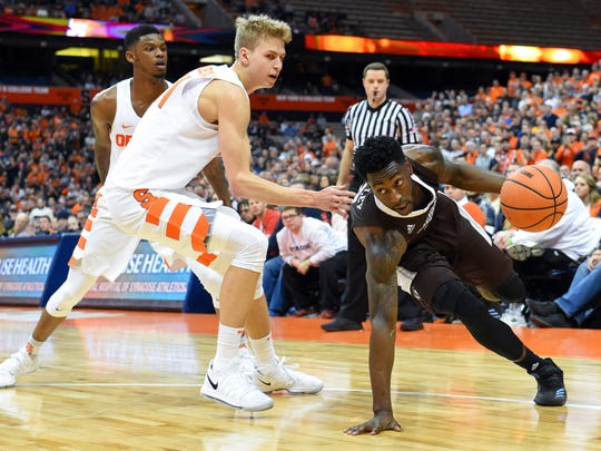 St. Bonaventure guard Matt Mobley (2) controls the ball as Syracuse forward Marek Dolezaj (21) and guard Frank Howard defend during the second half Friday at the Carrier Dome.