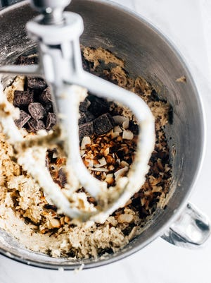 Mix-ins such as nuts and chopped chocolate should be added for mixing in along with the last streaks of flour.