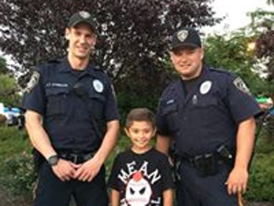Piscataway police officers interact with youth during