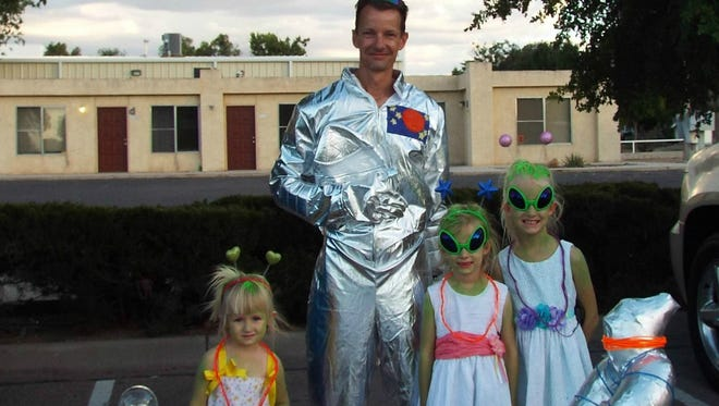 Jeff Casey and his daughters (left to right: Alleyah, 3, Hailey, 6, Savannah, 8) participated in the annual Alien Light Parade on Saturday at the 2016 UFO Festival in Roswell. The Casey family won best lights in the parade.