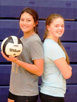 Seton Catholic High School volleyball seniors Abbey Schmidt, left, and Sarah Dickman