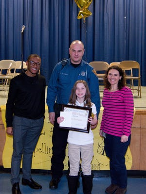 Taylor Bushman, a fourth grader, was crowned champion during Dane Barse School's Scripps School Spelling Bee on Feb. 15.