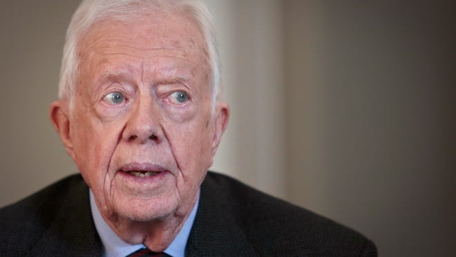 Jimmy Carter said he now hand-writes and mails sensitive letters to foreign and American leaders because he can't trust his email or telephone to be secure.