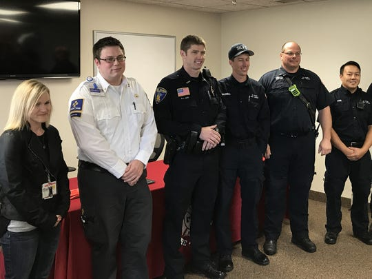 Gold Cross Ambulance honored a St. Cloud crew Monday, Oct. 9, for delivering a baby outside the hospital. Honorees included, from left: Paramedics Alisa Moore and Jeffrey Frank, St. Cloud Police Officer Brian Heim, Firefighter Kyle Gammell, Fire Department Capt. Glen Koshiol, Firefighter True Vang and Fire Apparatus Operator Benjamin Rakotz who posed for a photo at the St. Cloud Fire Department.