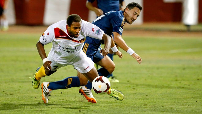 Jon Okafor (7) of Arizona United and Stefan Ishizaki (24) of the LA Galaxy, fumble for the ball during the fourth round U.S. Open Cup match Wednesday, June 18, 2014, at the Peoria Sports Complex in Peoria, Az.